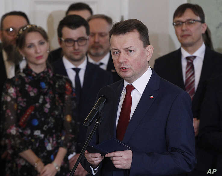 FILE - Polish Defense Minister Mariusz Blaszczak attends a government swearing-in ceremony at the Presidential Palace in Warsaw, Poland, Jan. 9, 2018.