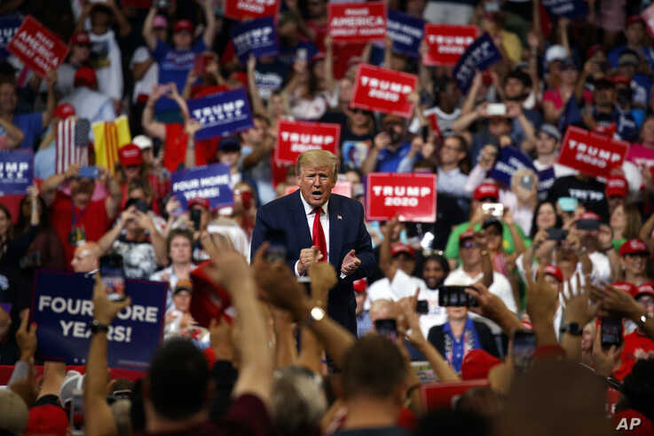 President Donald Trump reacts to the crowd after speaking during his re-election kickoff rally at the Amway Center, Tuesday, June 18, 2019, in Orlando, fla.