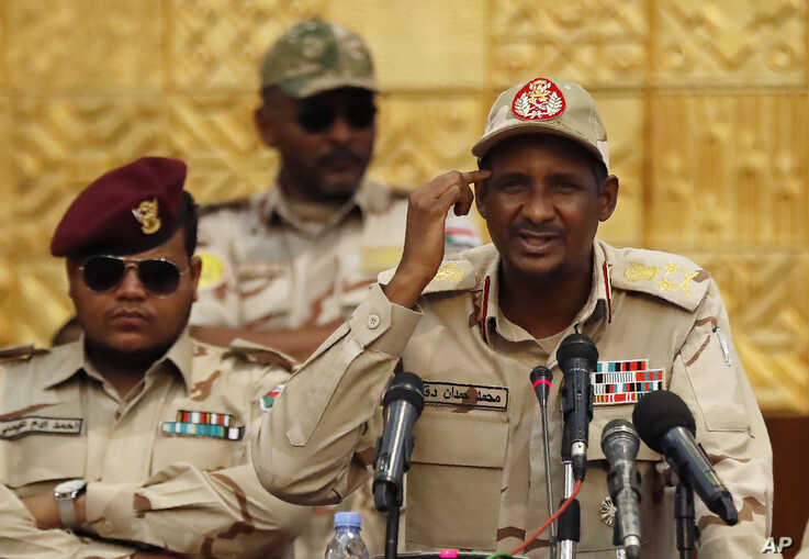 Gen. Mohammed Hamdan Dagalo, the deputy head of the military council, speaks during a military-backed women's rally, in Khartoum