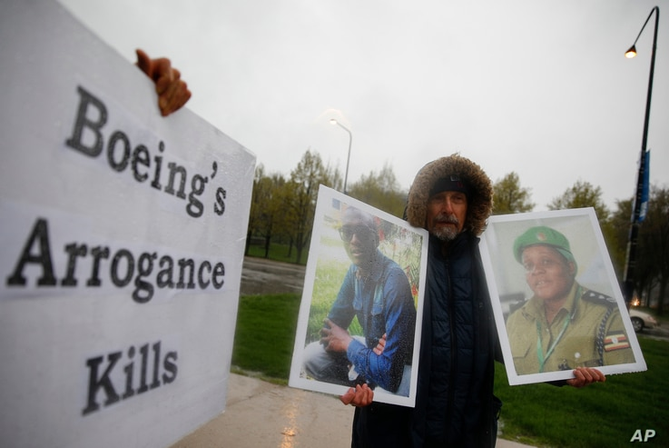 Protester Gene Stilp holds the photographs of victims in the Ethiopian Airlines Flight 302 plane crash, outside Boeing's annual shareholders meeting at the Field Museum in Chicago, April 29, 2019