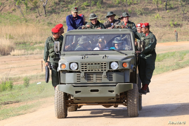 Venezuela's President Nicolas Maduro drives a vehicle during his visit to a military training center in El Pao, Venezuela, May 4, 2019.