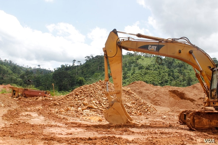 Excavators lie still at a small-scale gold mining site at the foot of the Atewa forest reserve in southeastern Ghana while government officials review the owners' paperwork, May 23, 2019.