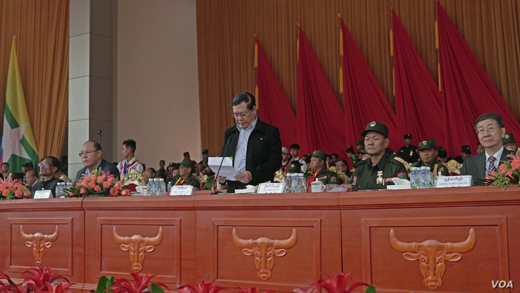 Union Minister U Thein Swe reads out statement from ASSK , standing next to UWSA chief Bao Youxiang (w/hat) and China Special Envoy for Asian Affairs, Sun Guoxiang (far Right) during 30 year anniversary April 17 in Panghsang, Special Region 2. (Am Sa...
