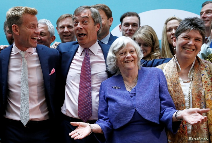 Leader of the Brexit Party Nigel Farage and newly elected Members of the European Parliament from Brexit Party attend a news conference following the results of the European Parliament elections, in London, Britain, May 27, 2019.