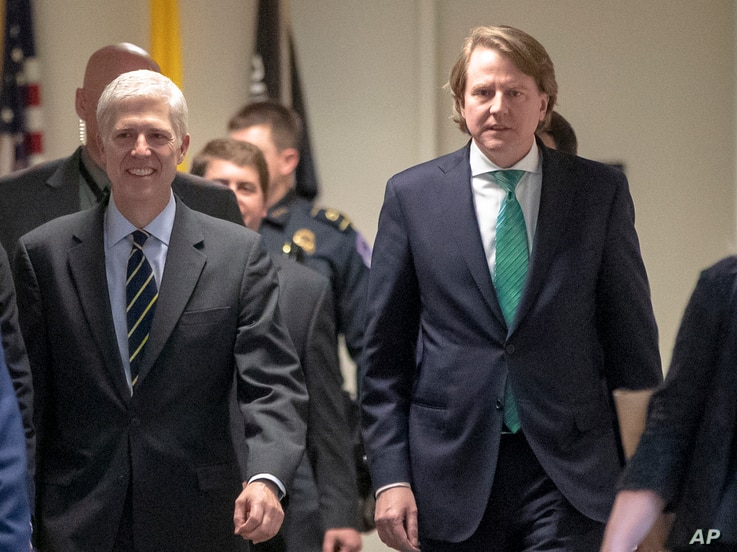 FILE - President Trump's White House counsel, Don McGahn, right, is seen on Capitol Hill in Washington, Feb. 6, 2017.