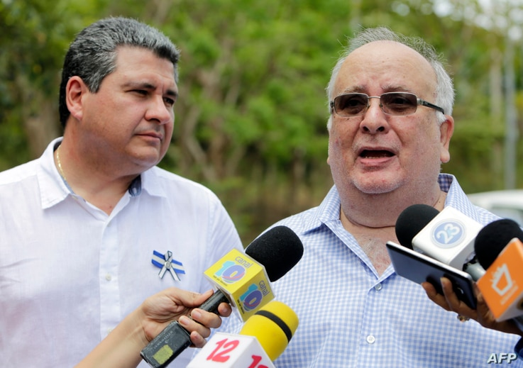 FILE - Nicaragua's Civic Alliance member Jose Pallais, right, speaks before a meeting with members of the government at The Central American Institute of Business Administration (INCAE) in Managua, May 6, 2019.