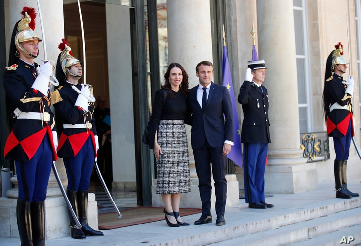 New Zealand Prime Minister Jacinda Ardern, center left, is greeted by French President Emmanuel Macron, center right, as she arrives at the Elysee Palace, in Paris, May 15, 2019.