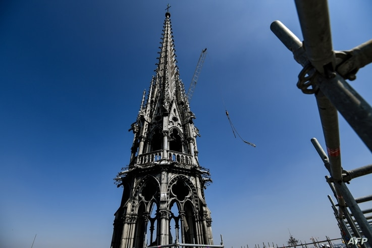 FILE - A picture take on April 11, 2019 shows the spire of Notre-Dame de Paris Cathedral during restauration works, in Paris.