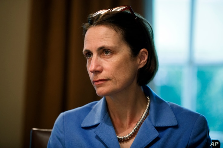 FILE - Fiona Hill, senior director for European and Russian Affairs on the National Security Council, is seen during a meeting in the Cabinet Room of the White House, April 2, 2019, in Washington.