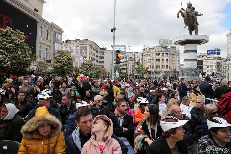 People wait for Pope Francis to arrive and lead the Holy Mass at the Macedonia square in Skopje, North Macedonia, May 7, 2019.