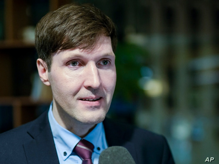 FILE - Martin Helme, son of Chairman of the Estonian Conservative People's Party (EKRE) Mart Helme, the party vice chairman and the leader of EKRE's parliamentary faction, speaks to journalists at the headquarters after parliamentary elections in Tal...