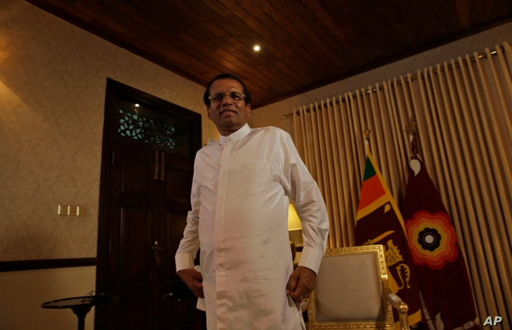 Sri Lankan President Maithripala Sirisena smiles as he leaves after an interview with the Associated Press at his residence in Colombo, Sri Lanka, Tuesday, May 7, 2019.