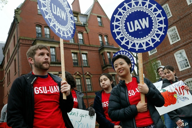 Union protesters march at Harvard University in Cambridge, Mass., May 1, 2019.