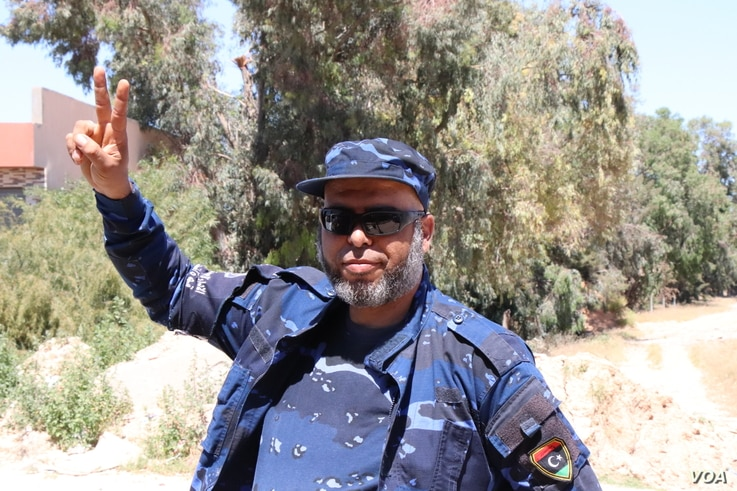 Mohammed Turkey, a special forces soldier for forces based in Tripoli, says tanks, machine guns and heavy artillery were used in a fierce fight in the suburbs of Tripoli, Libya, April 29, 2019.