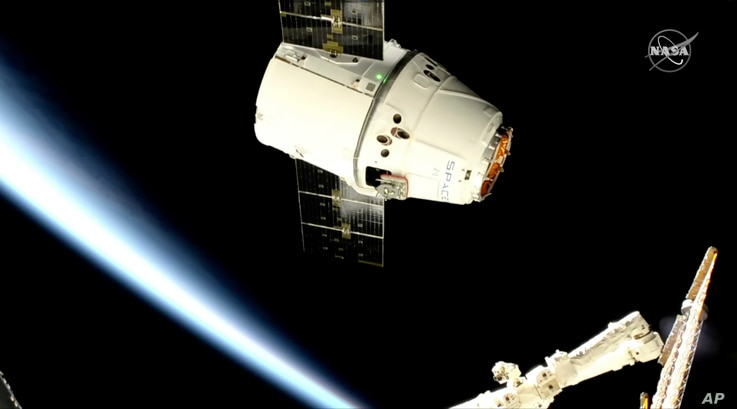 In this image taken from NASA Television, a SpaceX shipment prepares to arrive at the International Space Station following a weekend launch, May 6, 2019.