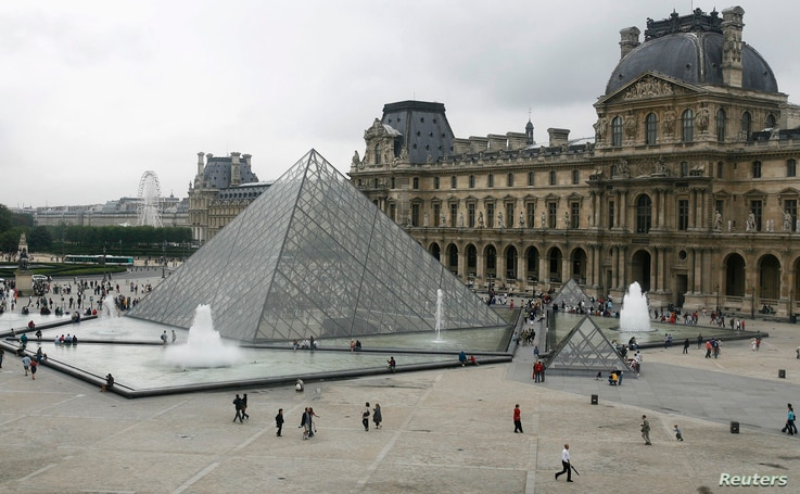 FILE - General view of the Louvre Museum in Paris, with the glass Pyramid entrance designed by Chinese-born U.S. architect I.M. Pei, Aug. 6, 2007.