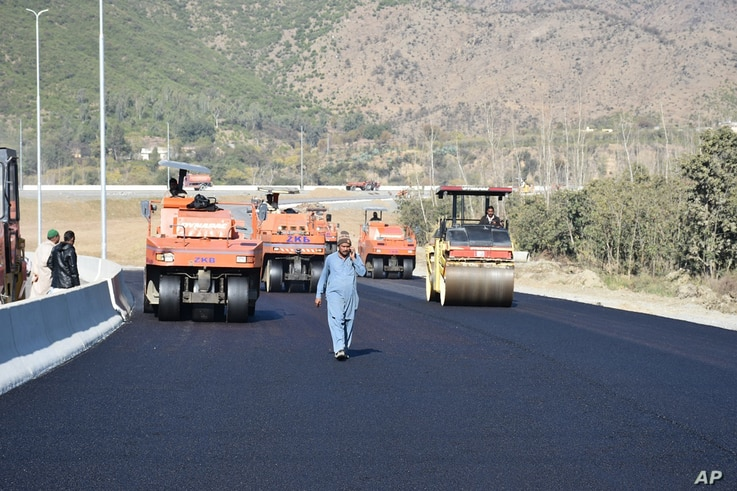 FILE - Road construction is underway as part of China's 'Belt and Road' Initiative, in Haripur, Pakistan, Dec. 22, 2017.