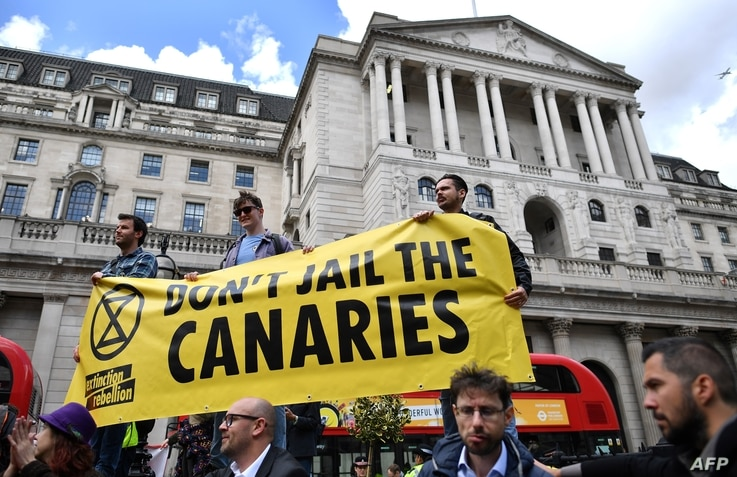 Climate change activists demonstrate opposite the Bank of England in the financial district in London, April 25, 2019, during environmental protests by the Extinction Rebellion group.
