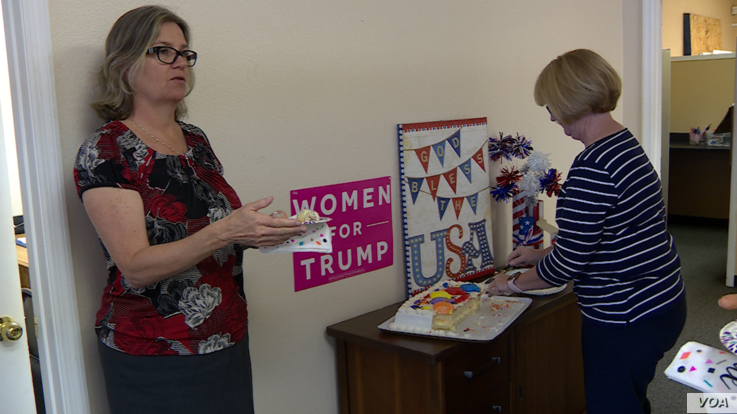 Trump campaign volunteers Linda Trocine and Hillary Courson shares cake to celebrate the president's birthday. (VOA video grab)