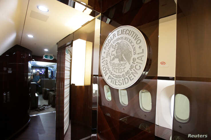 FILE - Mexico's official government seal is seen on a wall of the Mexican Air Force Presidential Boeing 787-8 Dreamliner at Benito Juarez International Airport in Mexico City, Mexico Dec. 2, 2018.