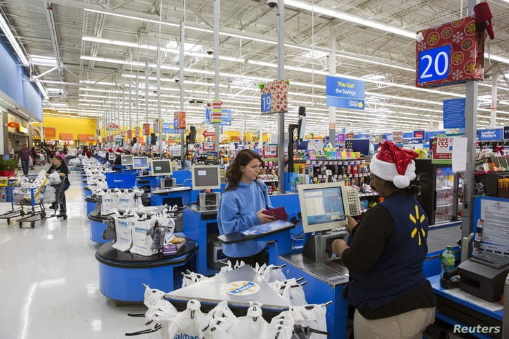 FILE - US customer shops at Walmart, which has warned along with other major US businesses, that prices for shoppers will rise due to higher tariffs on goods from China.
