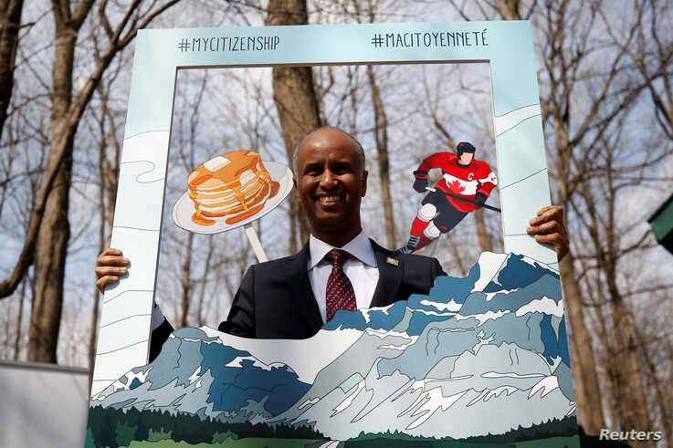 Canada's Immigration Minister Ahmed Hussen poses for photos following a citizenship ceremony at the Vanier Sugar Shack in Ottawa, Ontario, Canada, April 11, 2018.