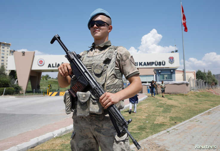 A Turkish soldier stands guard in front of the Aliaga Prison and Courthouse complex in Izmir, Turkey July 18, 2018.