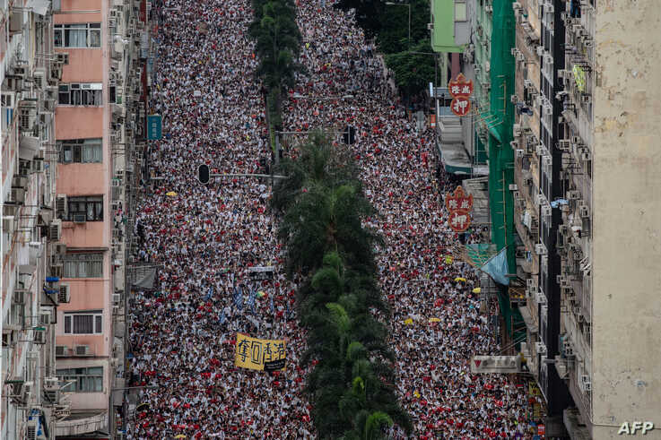Protesters march during a rally against a controversial extradition law proposal in Hong Kong,  June 9, 2019.