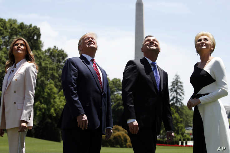 First lady Melania Trump, President Donald Trump, Polish President Andrzej Duda, and his wife Agata Kornhauser-Duda watch a flyover of a F-35 Lightning II jet at the White House, in Washington, June 12, 2019.