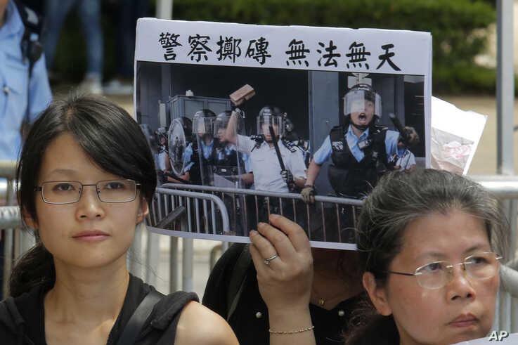 Various of activist groups from parents and religious protest outside the government office demanding to stop shooting their kids in Hong Kong, June 20, 2019.