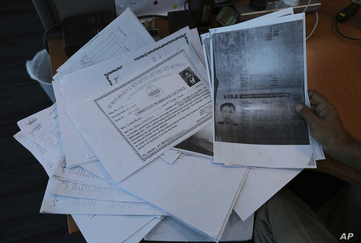 Photocopies of dozens of marriage contracts and other documents are collected by a Pakistani security agency, in Islamabad, May 27, 2019