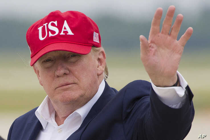 President Donald Trump waves as he steps off Air Force One after arriving, June 7, 2019, at Andrews Air Force Base, Maryland.