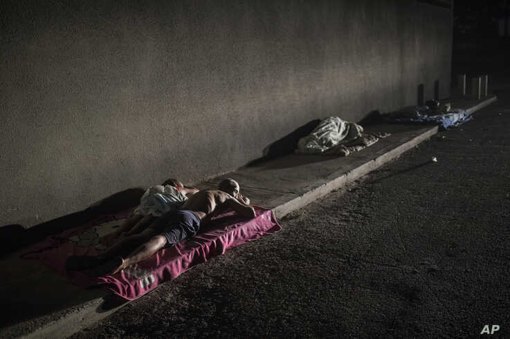 People sleep outside their homes during a blackout in the sweltering city of Maracaibo, Venezuela, May 15, 2019.