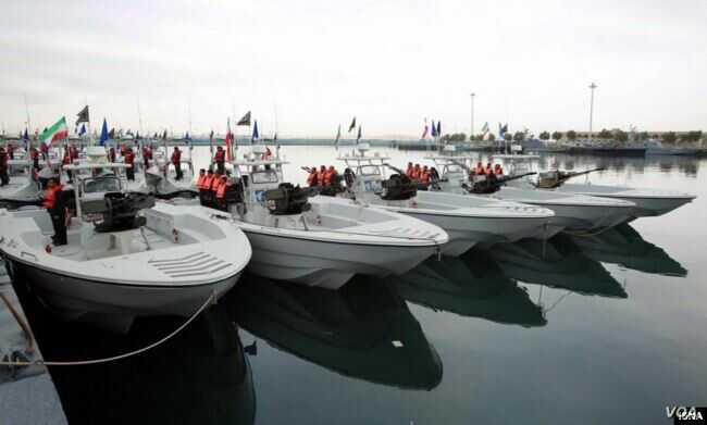 Screengrab from video showing Iranian speed boats during a March 2016 ceremony.