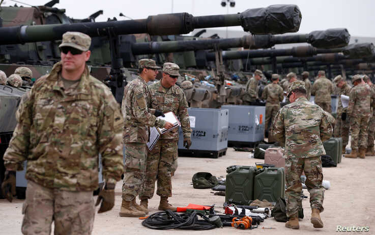 U.S. troops check military equipment after their deployment to Drawsko Pomorskie, Poland, March 21, 2019.