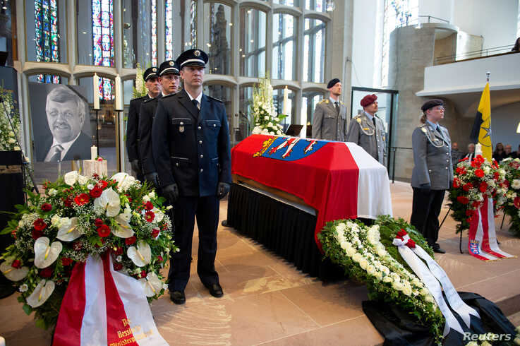 An honor guard made up of police and federal officers stands next to the coffin of Kassel District President Walter Luebcke, during his funeral at the St. Martin's Church in Kassel, Germany, June 13, 2019.