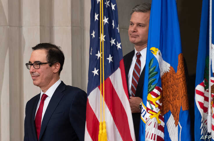 U.S. Secretary of Treasury Steven Mnuchin and FBI Director Christopher Wray, right, arrive at a summit on Combating Anti-Semitism at the Department of Justice in Washington, July 15, 2019.