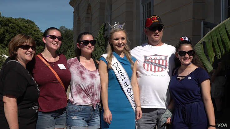 Miss DC 2019 Katelynne Cox posing with visitors at the U.S. Botanic Garden.