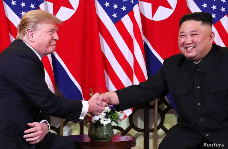 U.S. President Donald Trump and North Korean leader Kim Jong Un shake hands before their one-on-one chat during the second U.S.-North Korea summit at the Metropole Hotel in Hanoi, Vietnam, Feb. 27, 2019.