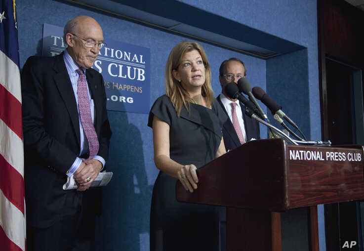 FILE - Maya MacGuineas, president of the Committee for a Responsible Federal Budget, center, speaks during a news conference on deficit reduction at the National Press Club in Washington, Sept. 12, 2011.