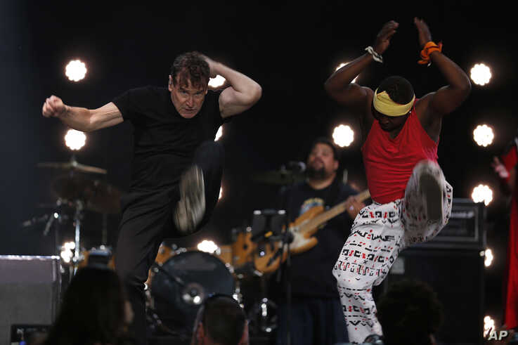 In this photo taken on Saturday, Nov. 11, 2017, musician Johnny Clegg on stage at a farewell concert in Johannesburg.
