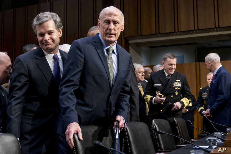 FILE - FBI Director Christopher Wray, left, and Director of National Intelligence Dan Coats, second from left, arrive for a hearing in Washington, Feb. 13, 2018.