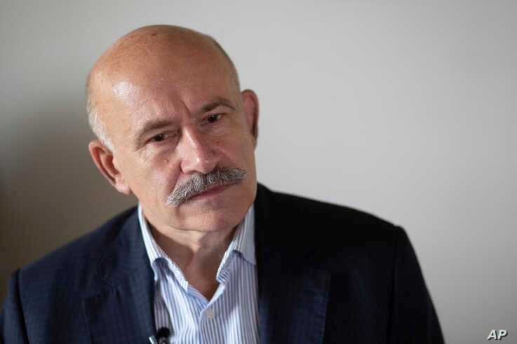 FILE - Pavel Palazhchenko, former chief interpreter for Soviet leader Mikhail Gorbachev, speaks during his interview to the Associated Press in Moscow, Russia, July 23, 2018.