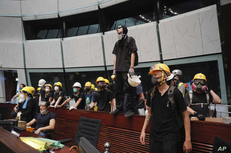 Protesters gather inside the meeting hall of the Legislative Council in Hong Kong, July 1, 2019.