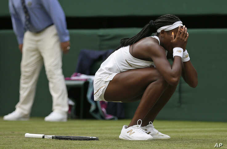 """United States' Cori """"Coco"""" Gauff reacts after beating United States' Venus Williams in a women's singles match during day one of the Wimbledon Tennis Championships in London, July 1, 2019."""