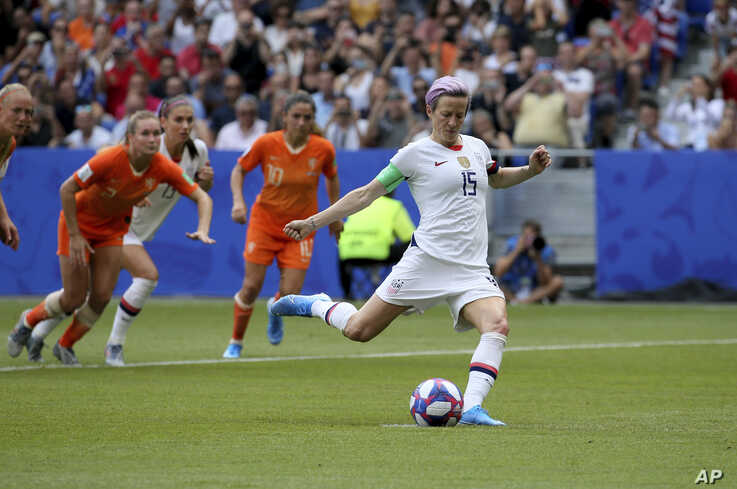 United States' Megan Rapinoe scores the opening goal from a penalty shot during the Women's World Cup final soccer match on July 7, 2019.