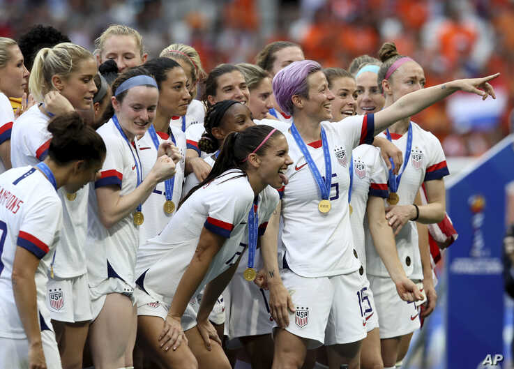 United States' Megan Rapinoe, center, celebrates team's victory with teammates after the Women's World Cup final soccer match between US and The Netherlands.
