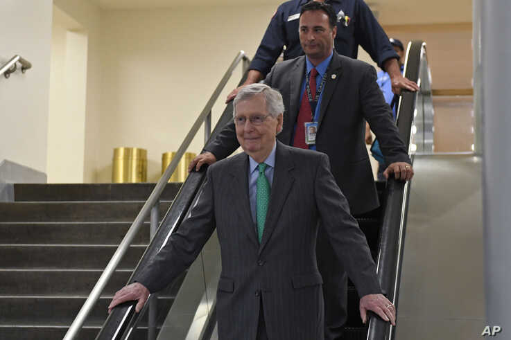 Senate Majority Leader Mitch McConnell of Kentucky rides the escalator to a briefing on election security on Capitol Hill in Washington, July 10, 2019.