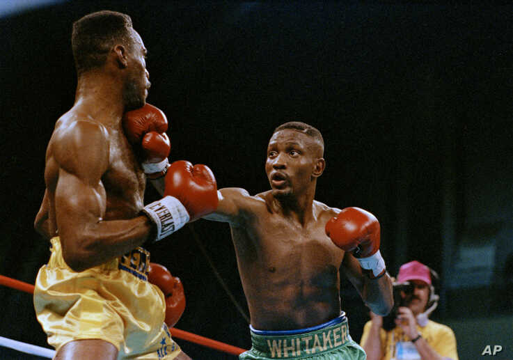 FILE - Pernell Whitaker, right, throws a punch at the chin of Freddie Pendleton in the second round of their IBF/WBC Lightweight Boxing Championship in Atlantic City, N.J., Feb. 4, 1990.