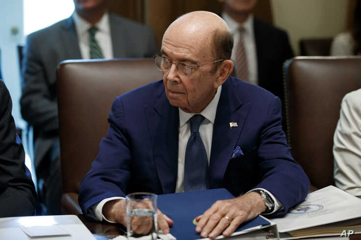 FILE - US Commerce Secretary Wilbur Ross listens during a Cabinet meeting in the Cabinet Room of the White House, July 16, 2019, in Washington.
